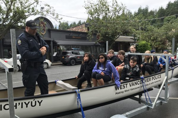 Constable Jeff Wood shares some history around the WVPD Youth Outreach Canoe.