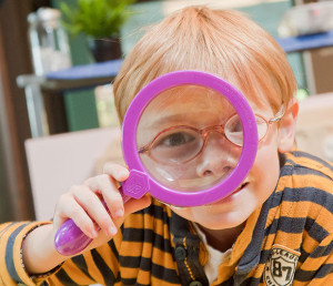 Student-with-magnifying-glass-LB