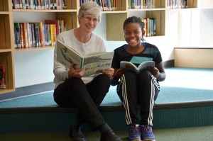 Julie Hunt shares some quiet time together with student Beatrice Audain.