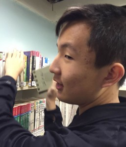 Fred organizing the book shelves at the Chinese library in downtown Vancouver