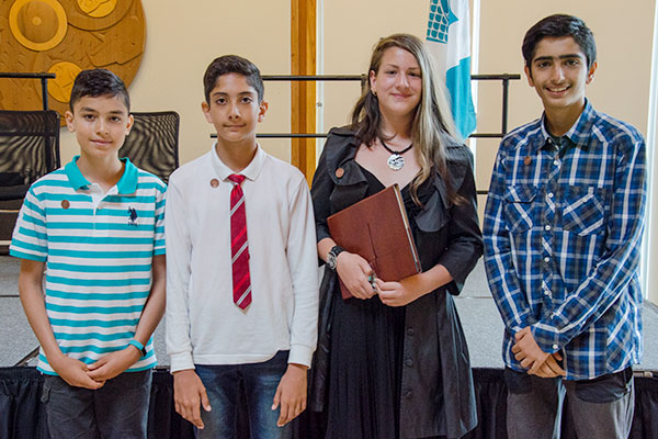 "Students from Hollyburn Elementary were honoured for their winning entries in the ""Imagine a Canada"" contest organized by the National Centre for Truth and Reconciliation. In photo: (L-R) Sam Talaifar, Aryan MosavianPour, Andra Pope and Ali Aryaeinia. Absent: Leila Cavers."